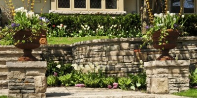 Natural-stone-home-entry-steps-and-retaining-wall-DT-5289486-e1411543291280